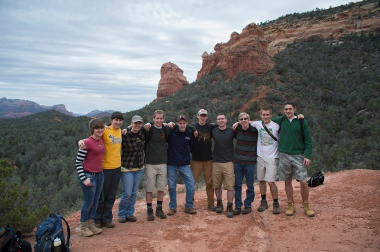 A student group photo with the Brins Ridge in the distance.