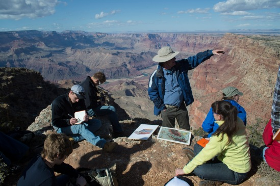 Dr. Steve Austin talks to the class discussing what makes up the layers of the Grand Canyon.