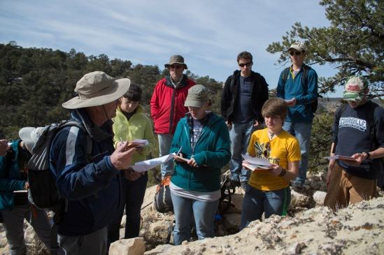 On the walk down, Dr. Steve Austin talks with the students on how to describe limestones.