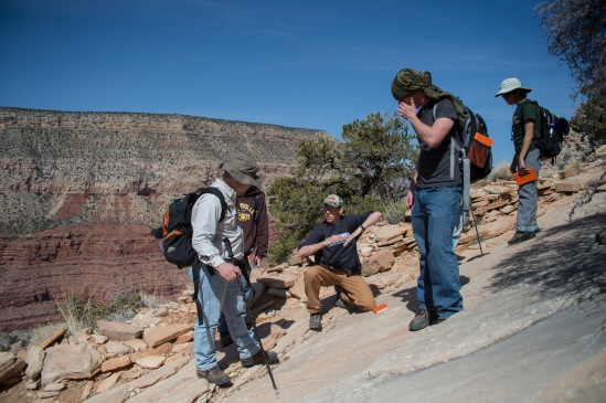 Dr. John Whitmore & students talk about the foot prints tracks in in the sandstone.