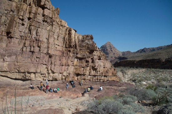 Looking down Peach Springs Canyon, Mr. Bill Hoesch talking with the students in front of the Great Unconformity.