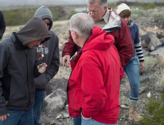 Dr. Whitmore looks at rock found near the Burro Creek Bridge.