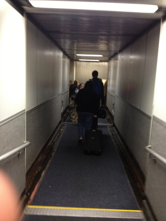 Finally boarding the airplane after a long Friday.