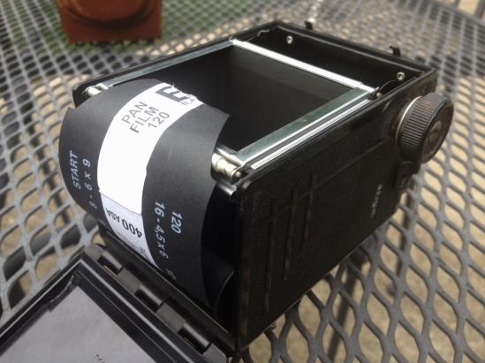 Loading Arista EDU 120 film into the camera.