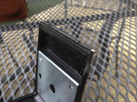 A small broken edge on the back enclosure. After loading the film and closing the enclosure, I used duct tape to seal the leak. The leather case helped.