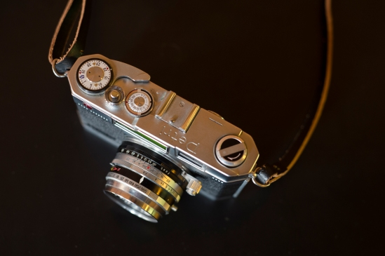 View of the top of the camera with exposure dial, ASA selector, shutter release & film advance.