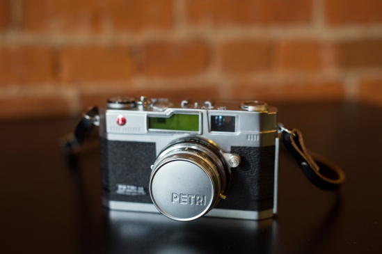 View of the front of the camera with the metal Petri lens cap.