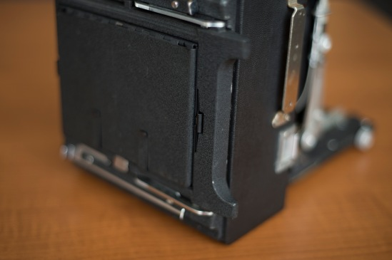 A closeup view of the Graphlock back which accepts 4x5 sheets film holders & Polaroid 545 film holders.