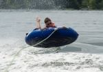 Chad catching alittle air while double tubing.