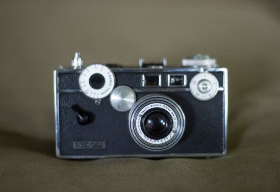 The shutter advance is on the left of the camera.