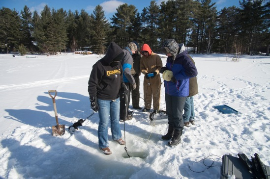 One would think we are ice fishing but we are collecting scientific data.