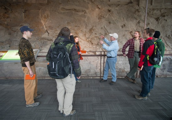 The students had an opportunity to observe dinosaur fossils in the cliff face at the Carnegie Quarry, Dr. Whitmore brought the students back together to discuss what they observed and give some possible explanation.