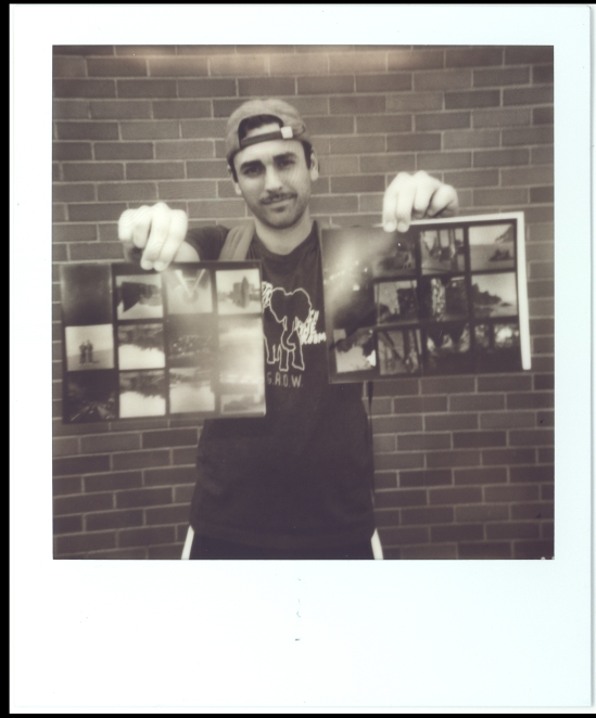 3) Dylan is showing off his freshly developed contact sheets.