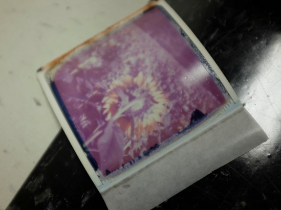 Typically to get a good image, you don't peel apart the negative from the Polaroid image until after 60-90 seconds.