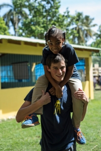 Steve having fun with one of the Makarios children during recess.