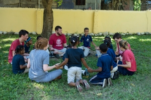 Many of the team members spending time with the children during their recess.