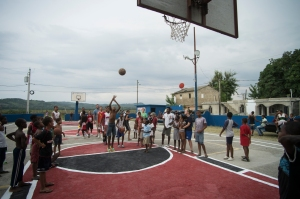 During the community outreach, we played the knock-out game on the newly painted basketball court and everybody played. It was a great time.