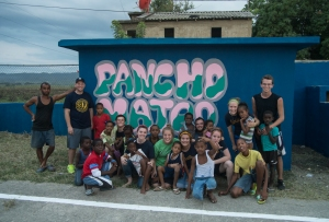 We had to take another group picture in front of the newly painted Pancho Mateo wall with many of the children that helped throughout the day.