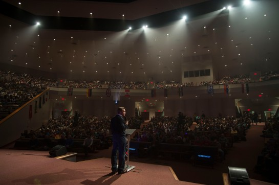 Day 008 - Dr. White greets the student body during the evening CU missions conference.